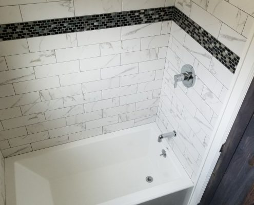 tiny house bathtub, subway tiles
