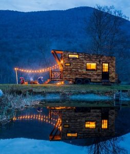 Arcadia Tiny House at Night with pond